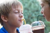 Funny Little Children Drink Milkshake