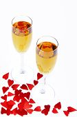 Two Wine Glasses And Small Hearts