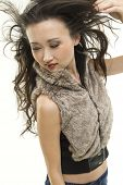 picture of blown-up  - A beautiful Asian woman with her hair blown back - JPG