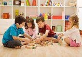 picture of indoor games  - Children playing with blocks on the floor  - JPG