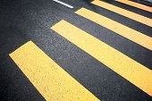 stock photo of zebra crossing  - Crosswalk yellow lines on the road - JPG