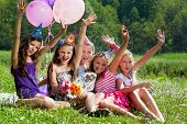 stock photo of youngster  - beautiful girls celebrate birthday in summer park outdoors - JPG