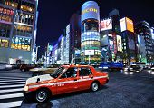 TOKYO - DECEMBER 26: A taxi stops in the Ginza District December 26, 2012 in Tokyo, JP. The Ginza district extends for 2.4 km and is one of the world's best known shopping districts.