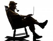 sherlock holmes with computer laptop silhouette sitting in rocking chair in studio on white background