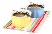 Chocolate pudding in bowls for baking isolated on white