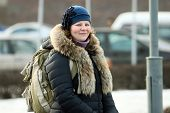 Smiling Russian Woman With Knapsack