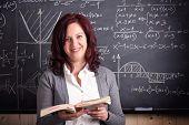 portrait of woman teacher and blackboard background
