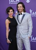 LAS VEGAS - APR 07:  Jake Owen & Lacey Buchanan arrives to the Academy of Country Music Awards 2013
