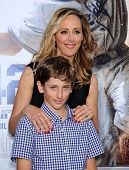 LOS ANGELES - APR 09:  Kim Raver & son Luke arrives to the '42' Hollywood Premiere  on April 09, 201