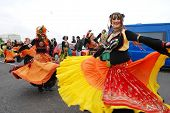 HASTINGS, ENGLAND - MAY 7: Dancers perform during a parade on the West Hill at the annual, May Day,  Jack In The Green festival on May 7, 2012 in Hastings, East Sussex.