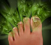stock photo of human toe  - Foot Odor and smelly feet concept with human toes releasing an awful stink as green monster faced gases coming from the sweaty perspired skin as a podiatric medicine health symbol of bacterial infection - JPG