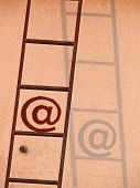 Ladder leaning against wall, Email icon, at symbol Concept