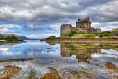 image of shoreline  - Eilean Donan castle on a cloudy day - JPG