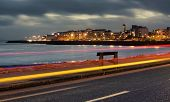 picture of galway  - City on the bank of ocean bay and light trails at night - JPG