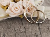 stock photo of vintage jewelry  - wedding rings in the vintage arrangement - JPG