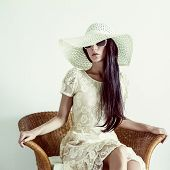 fashion portrait of a lady in a vintage chair