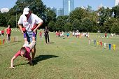 Father And Daughter Compete In Outdoor Wheelbarrow Race