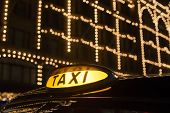 Taxi In London In Front Of A Shopping Center