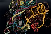image of barter  - a many jewelry on the black background - JPG