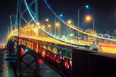 Bay Bridge perspective at night. San Francisco, California.