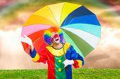 Happy clown holding an umbrella
