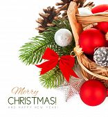 christmas balls with branch firtree and red bow isolated on white background