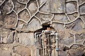foto of waterspout  - old urban wall with rusty water pipe tube in asia India - JPG