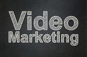 Finance concept: Video Marketing on chalkboard background