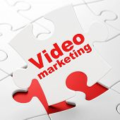 Finance concept: Video Marketing on puzzle background