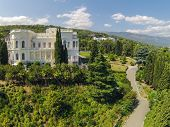 YALTA - AUG 29: Green trees in fron of the Livadia Palace on August 29, 2013 in Yalta, Ukraine. View