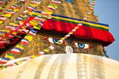 Close up: Bodhnath Stupa in Kathmandu with Buddha Eyes and prayer flags.