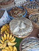 stock photo of cebu  - Baskets of dried salted fish for sale at a market in Bogo City Cebu Island Philippines - JPG