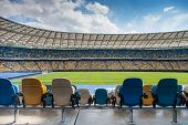 stock photo of grandstand  - Seat grandstand in an empty football stadium - JPG
