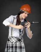 Girl In A Helmet Learns To Use A Drill