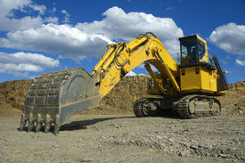 picture of open-pit mine  - Side view of an excavator for coal mine open pit with chains - JPG