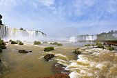 Fantastically spectacular boiling and thundering waterfalls of Iguazu. Waterfalls in Brazil. The pi
