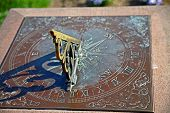 foto of sundial  - The shadow of a sundial in the summer - JPG