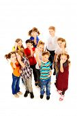 Group of angry children threatens fists into camera. Isolated over white. Full length portrait.
