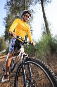 Young Man Riding Mountain Bike Mtb In Jungle Track Use For Sport Extreme Adventure Healthy And Holid