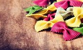 Fresh Fresh Italian Pasta On Old Vintage Wooden Table. Raw Bow Tie Colourful  Pasta Close Up.