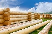 image of house woods  - building a house from wooden logs against the sky - JPG