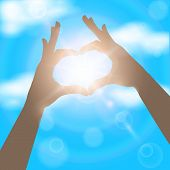 Hands In The Form Of Heart On The Background Of Blue Sunny Sky.