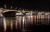 Margaret Bridge Across The Danube River By Night. Budapest, Hungary
