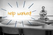 The word help wanted against lecturer sitting in lecture hall
