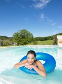 Smiling Woman Floating In Pool