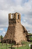 stock photo of pueblo  - Old belltower from San Geronimo Chapel in Taos Pueblo USA - JPG