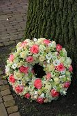 pic of sympathy  - Sympathy wreath near a tree pink and white roses - JPG