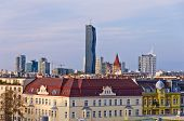 Vienna cityscape at sunset, contrast between modern skycrapers and old style buildings