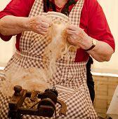 Elderly Woman Spinning Wool