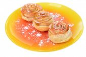 Tasty  puff pastry with apple shaped roses with powdered sugar isolated on white